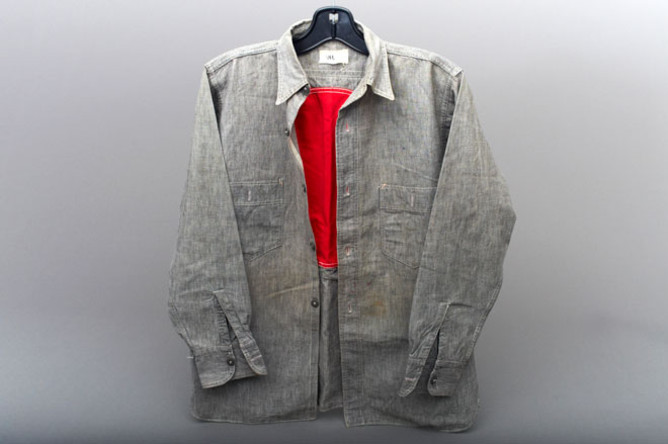 The circle has been covered over with more grey denim on the outside, and is only visible from the inside of the shirt.