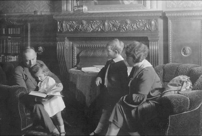 Four members of the Josephy family seated in their elegant living room.