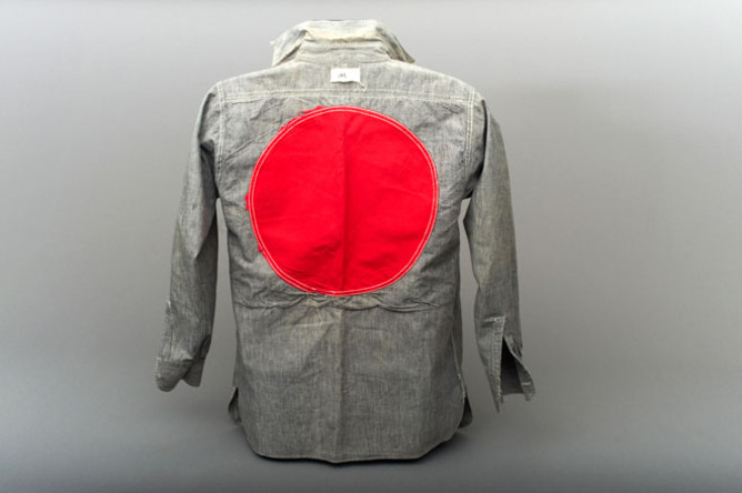 On the back, a large red circle has been sewn into the fabric.