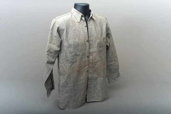 A grey denim long-sleeved collared shirt.